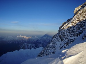 The shadow of Everest cast on the sky by the rising sun of a new dawn